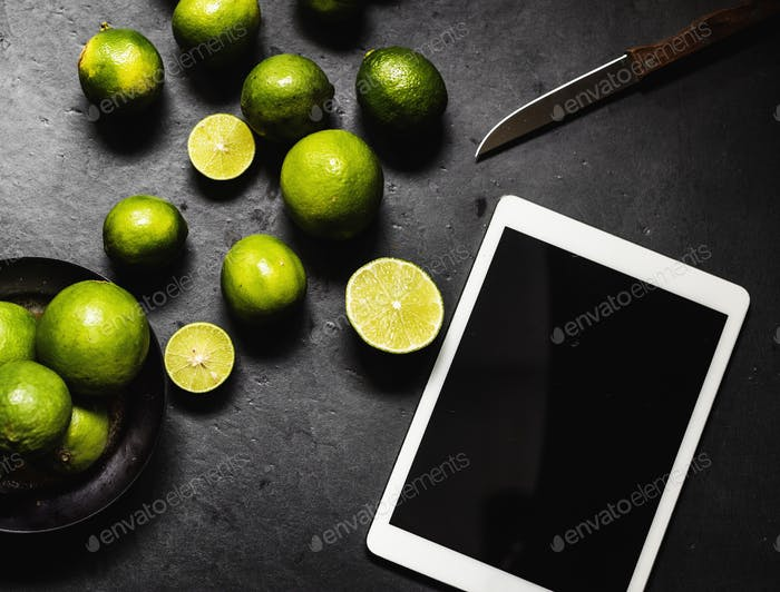 Closeup of fresh lime with digital tablet