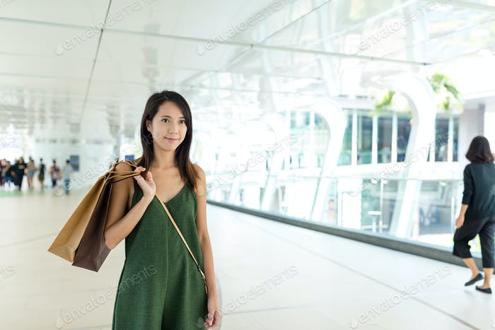 Woman shopping and carry shopping bag