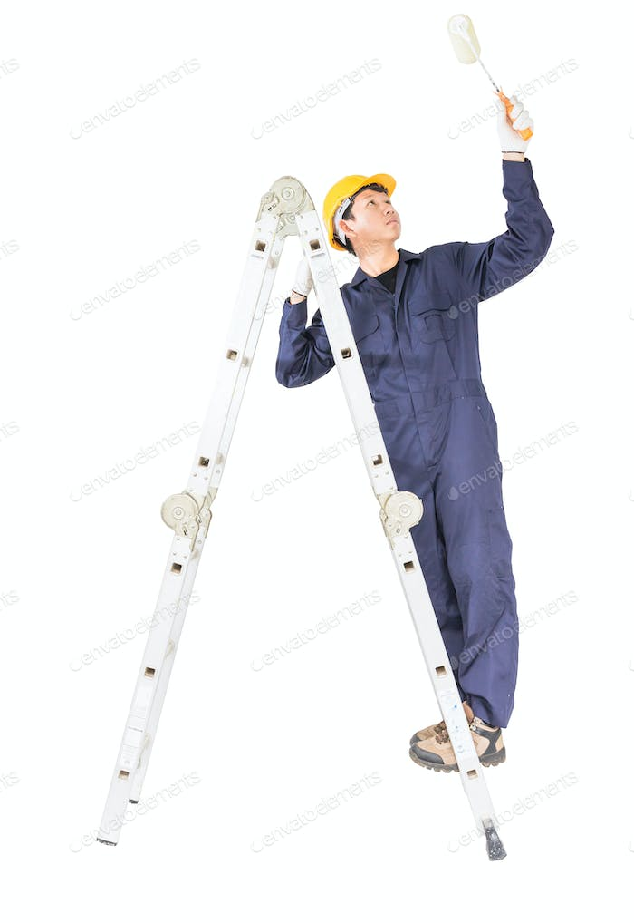 Man standing on ladder while using paint roller with clipping path 1