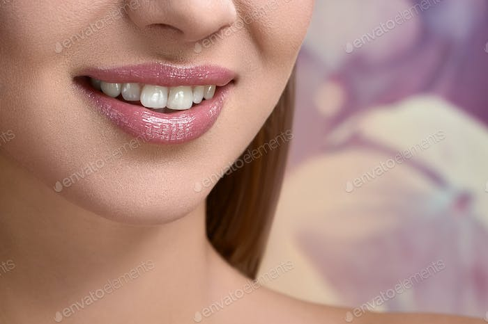 Cropped shot of a perfect smile of a beautiful girl