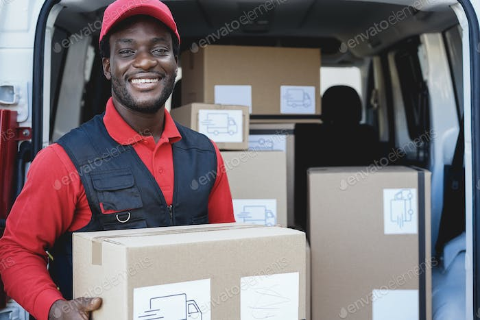 Black courier man delivering package in front of cargo truck - Focus on face