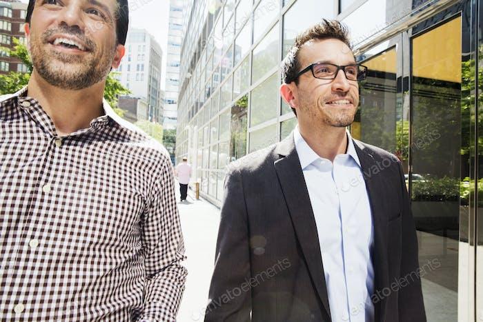 Two men walking down a city street.
