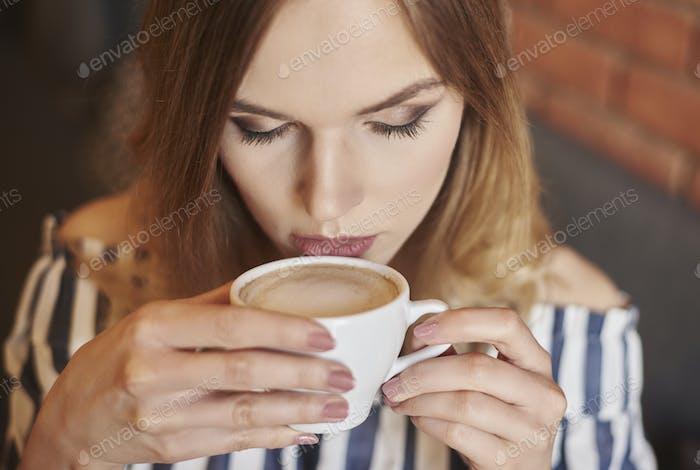 Headshot of woman drinking coffee