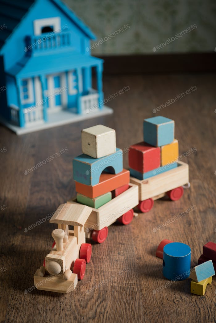 Wooden toy train and doll house