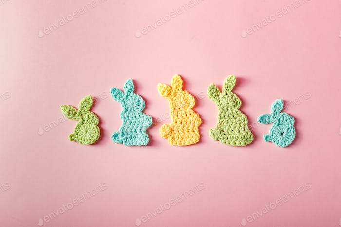 Easter decoration, bunny rabbits made of crochet colorful yarn. Homemade decor.