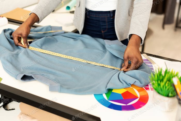 Unrecognizable Clothing Designer Working On A Garment In Atelier, Cropped