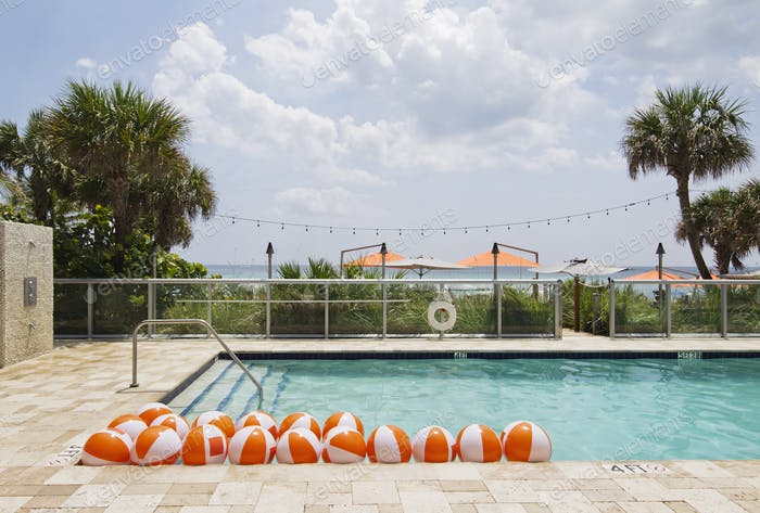 Beach balls in swimming pool