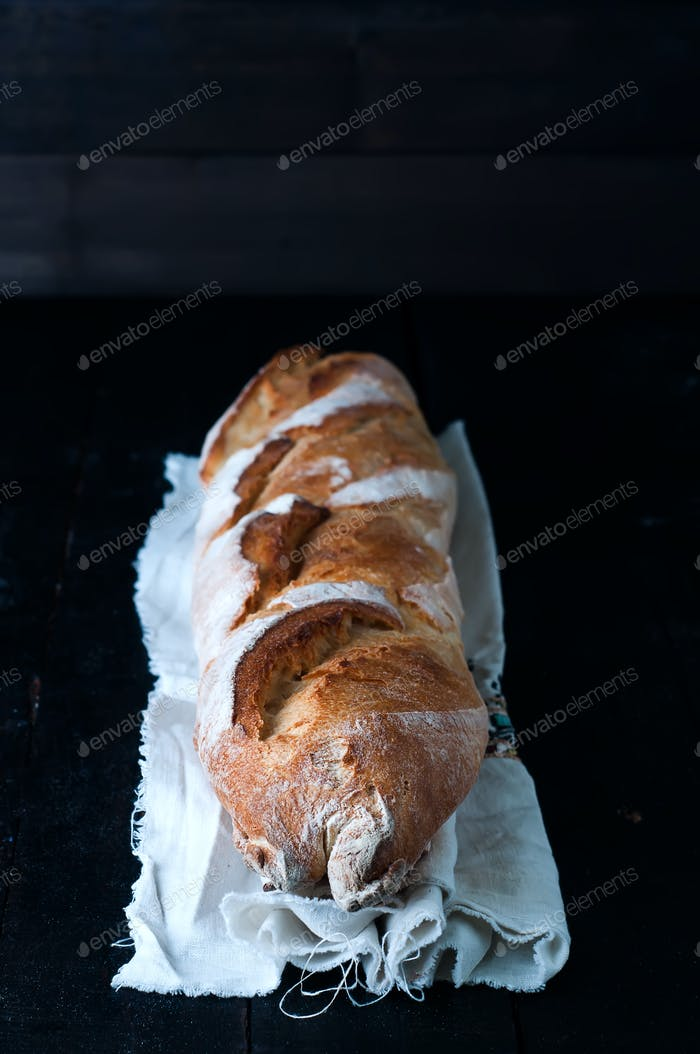 Baguette on black background.