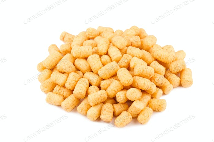 side view of corn puff snacks pile isolated on white