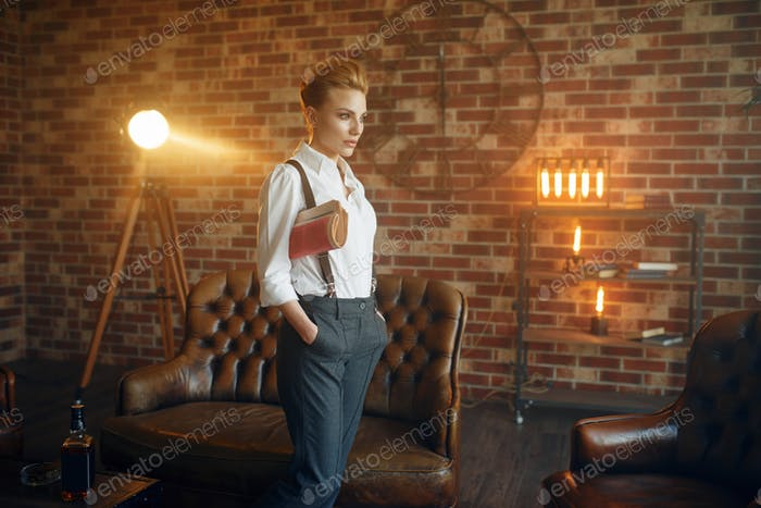 Woman in shirt and trousers with suspenders, retro