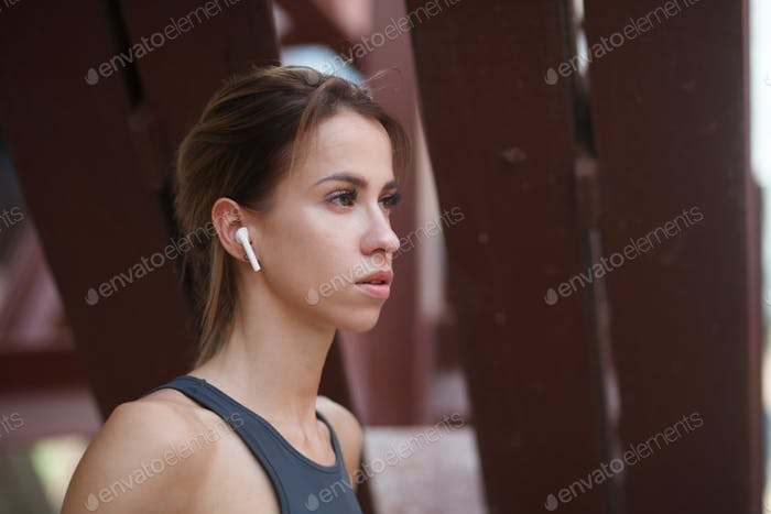 sporty woman with wireless headphone
