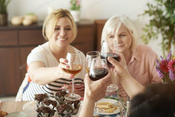 Making celebratory toast for long friendship