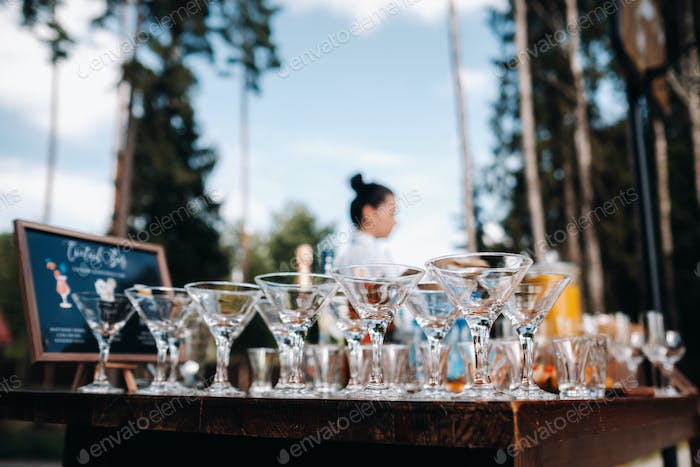 A lot of empty glasses are on the table for the beginning of the holiday