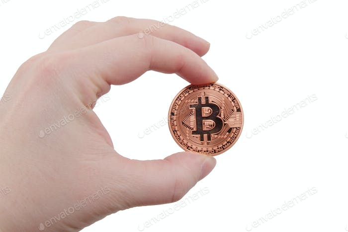 Bitcoin coin in a hand on a white background