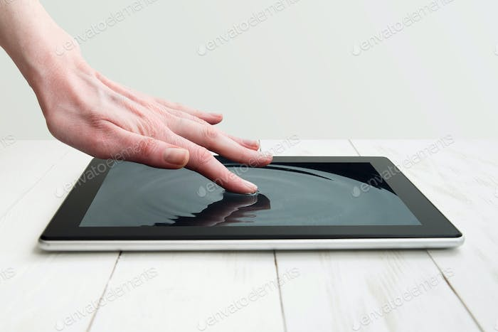 human hand touching futuristic screen
