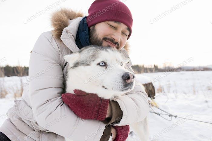 Asian Man with Loving Pet
