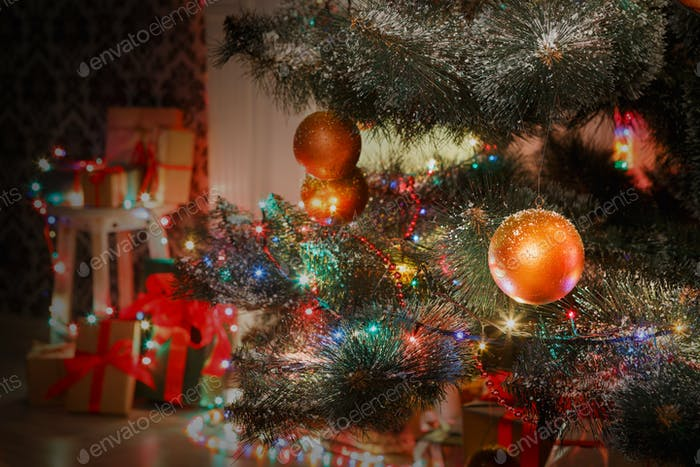 Beatiful christmas decorated tree in shining lights