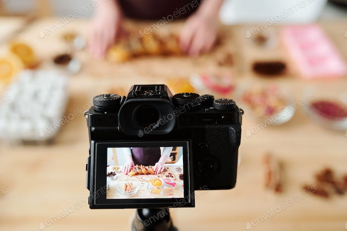 Home camera during video recording of master class of soap making
