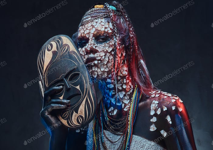 Portrait of a scary African shaman female with a petrified cracked skin and dreadlocks