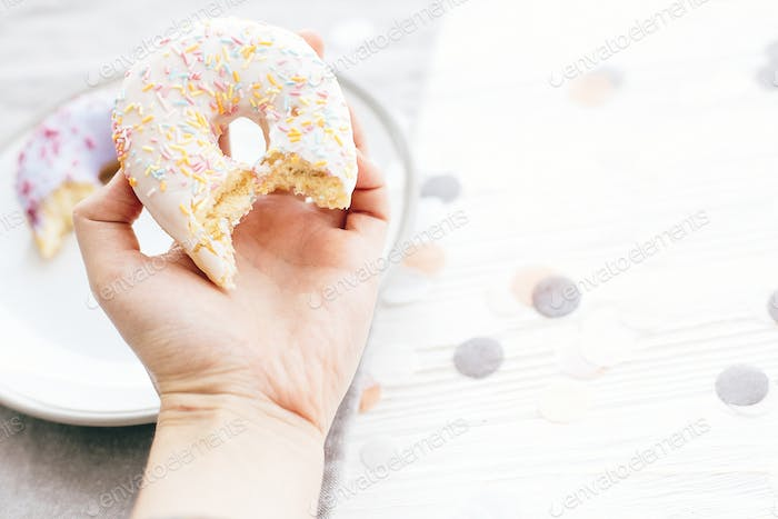 Delicious bite of donut with sprinkles