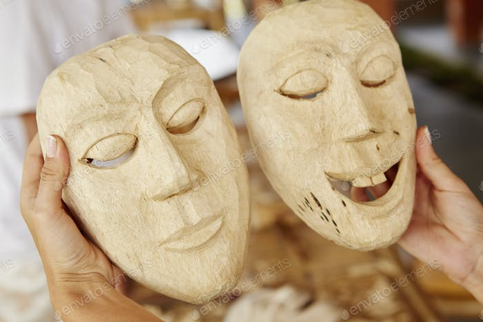 Two traditional wooden face masks, freshly carved.