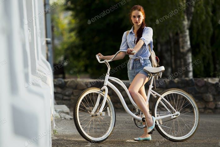 Girl and white bike