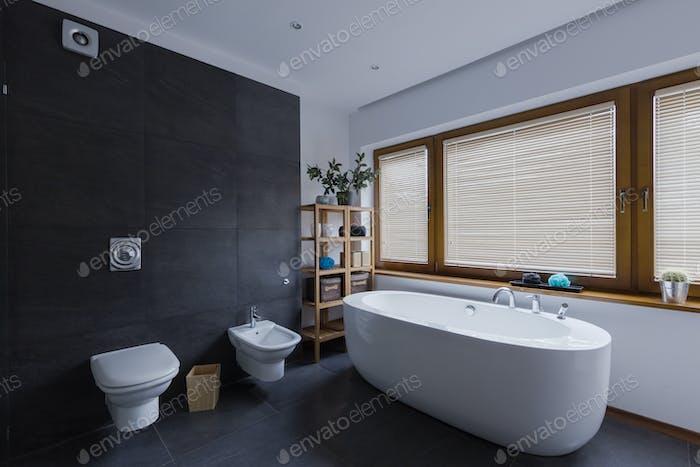 Modern dark bathroom with toilet