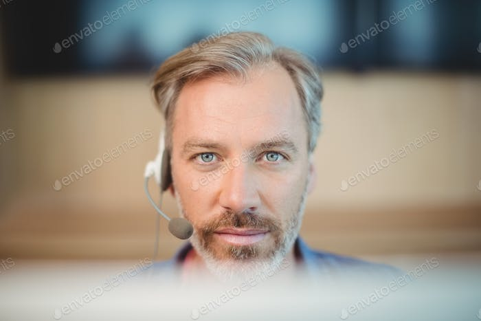 Male graphic designer working with headset