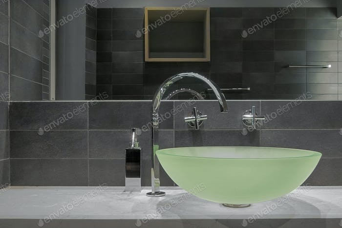 Close-Up of a Glass Countertop Washbasin in the Modern Bathroom Interior