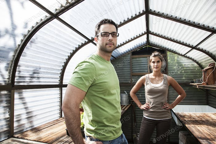 Hispanic couple in their new greenhouse