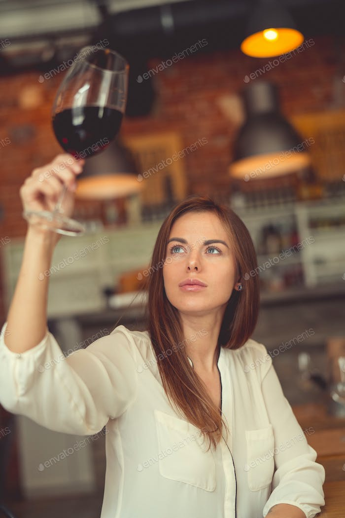 Young sommelier with a glass of red wine