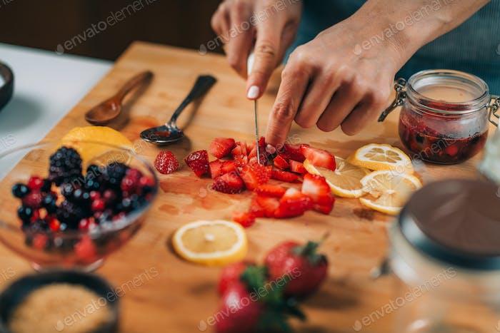 Woman Preparing Fruits for Fermentation.