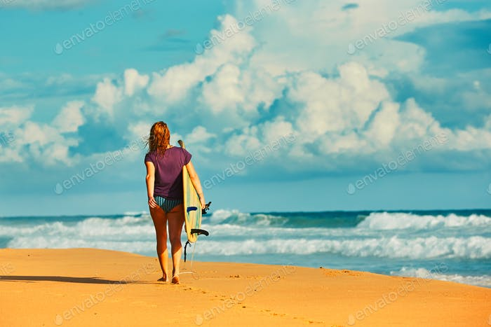 Surfer girl an the beach