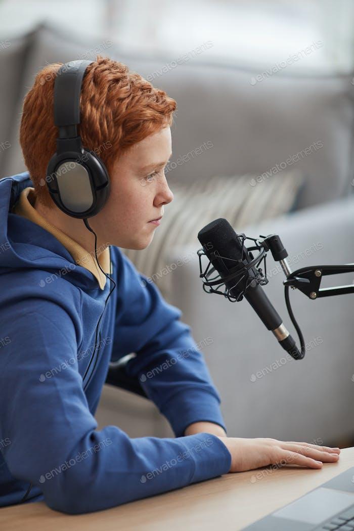 Teenage Boy Speaking to Microphone Side View