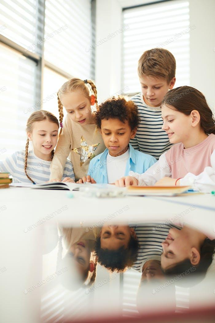 Children Helping Friend With Homework