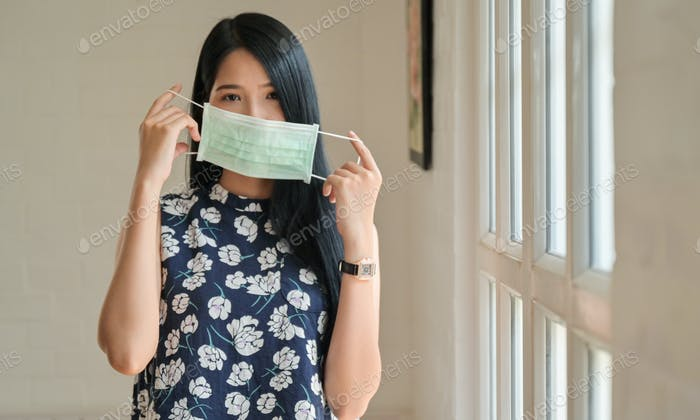 Asian teenage girls wearing masks to protect against Corona virus or Covid-19.