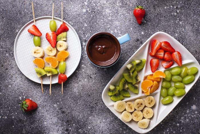 Sweet chocolate fondue with fruits