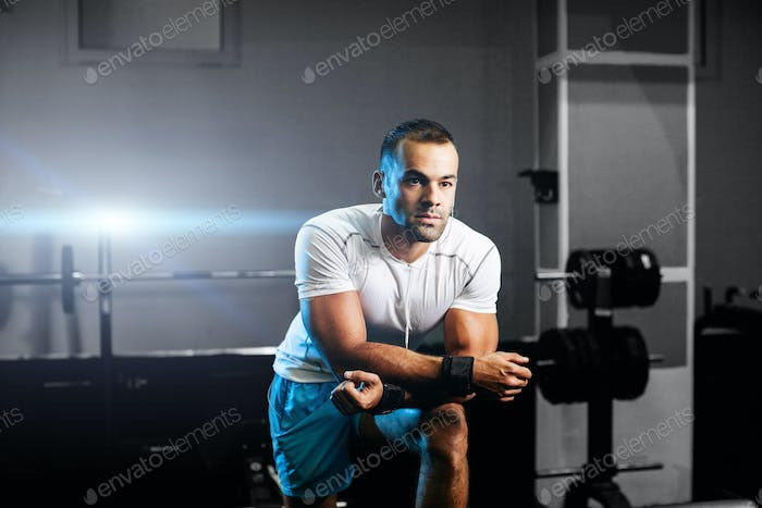 handsome fitness trainer in gym