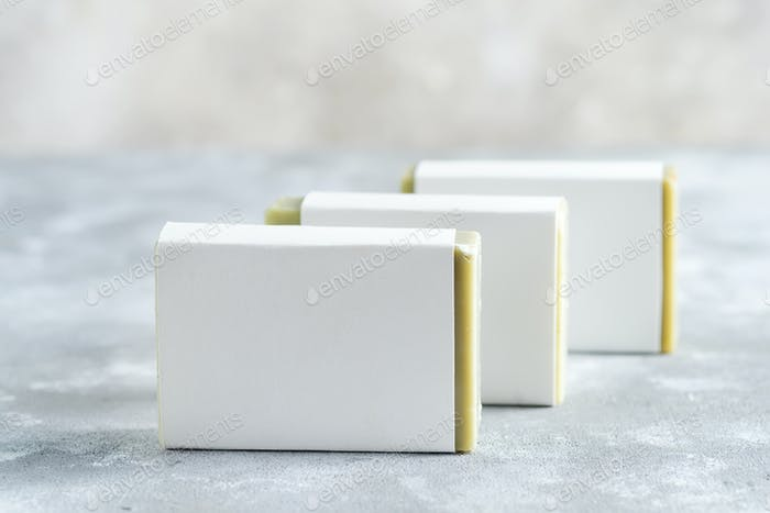Spa set from handcraft herbal natural soap bar on a marble grey background. Mock-up for your design