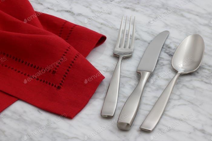 beautiful silverware on linen napkin