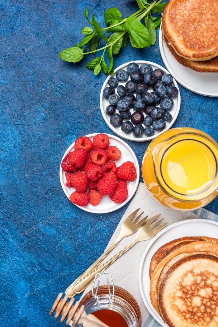 Fresh Healthy Pancakes with Fruits Toppings and Honey. Top Down View