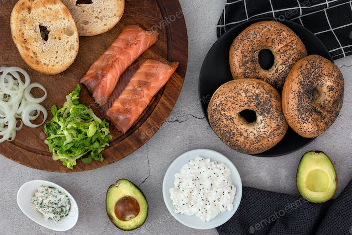 Ingredients for a salmon lox bagel arranged on a table