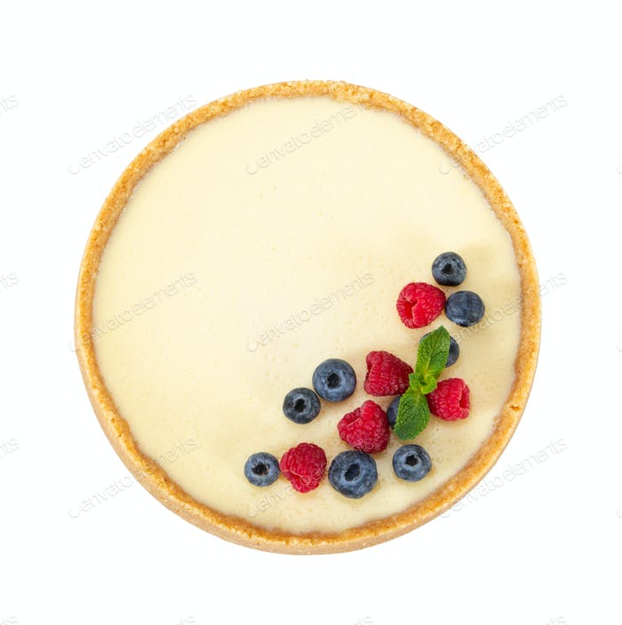 Cheesecake with raspberries, blueberries and mint isolated on wh