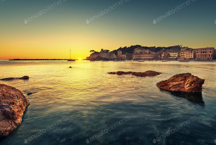 Sestri Levante, silence bay rocks, sea and beach view on sunset.