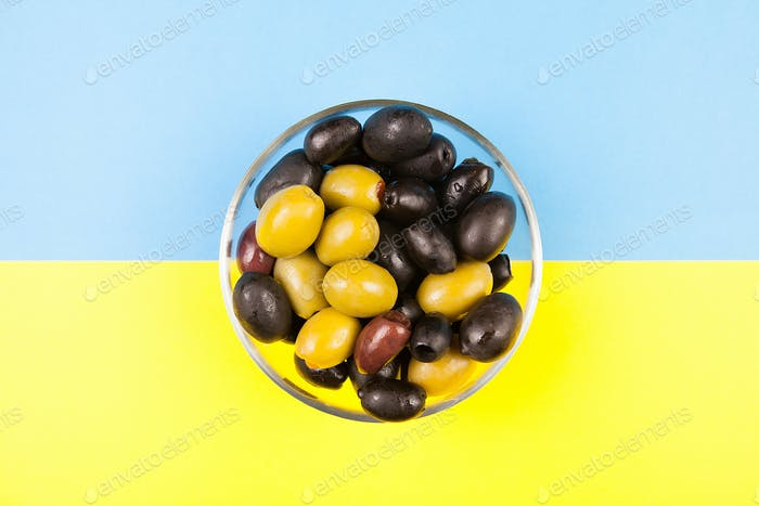 Top view on glass bowl with olives