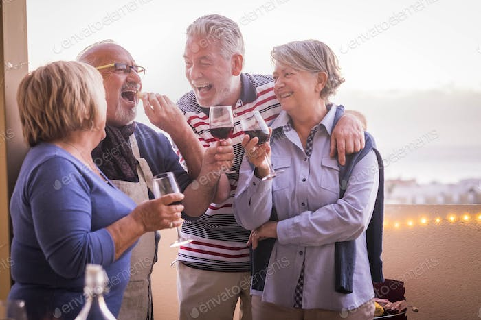 cheerful and smiling group of mature people enjoy the cocktail leisure activity