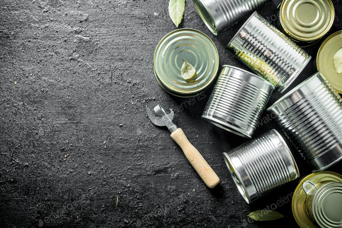 Group of tin cans with canned food.