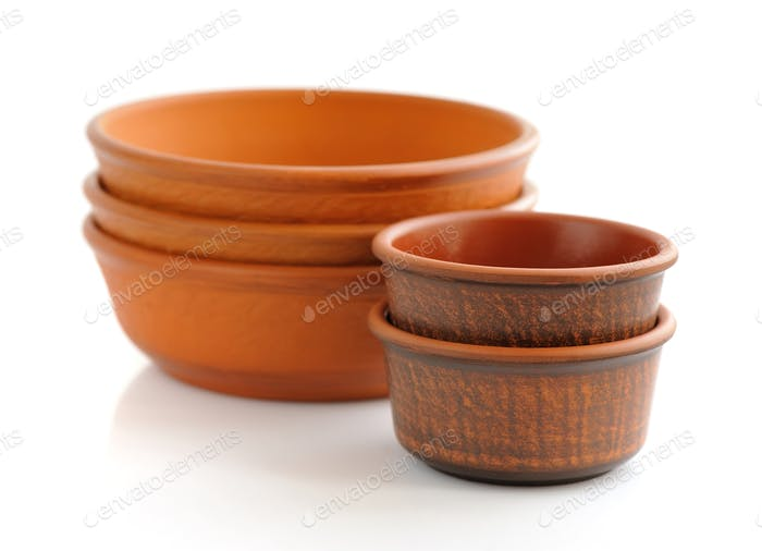 Ceramic dishes on white background
