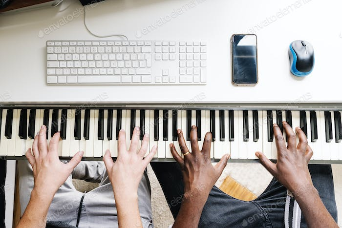 Artists producing music playing the piano.