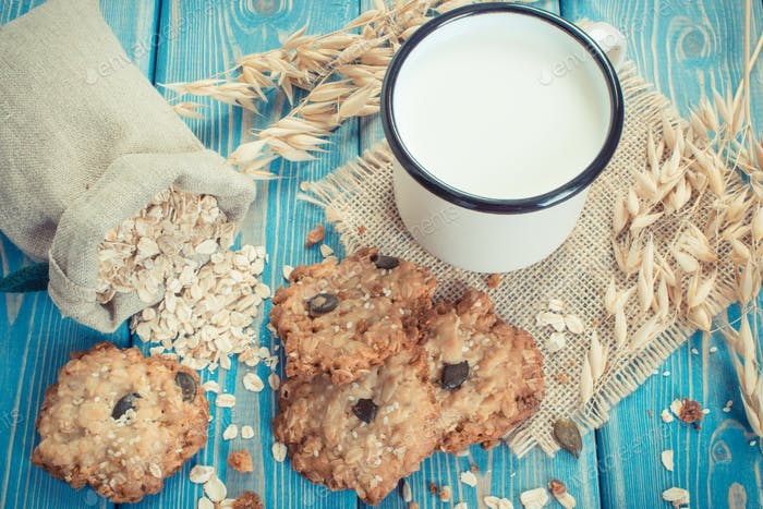 Vintage photo, Fresh baked oatmeal cookies, ingredients for baking and ears of oat